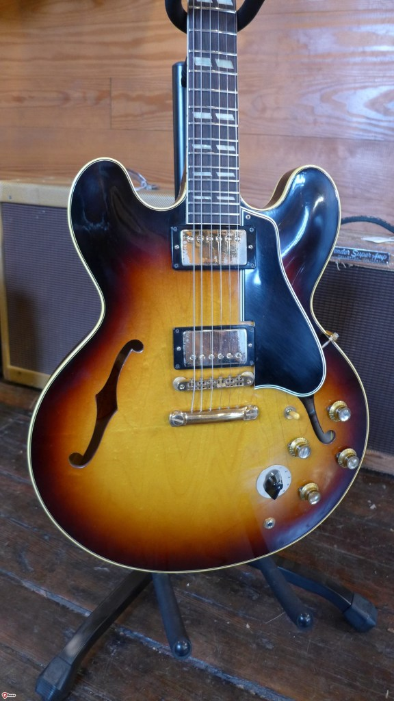 Near mint very early 60 ES-345. This is a stunningly clean guitar. If it wasn't for a little chip in the back of the headstock, I'd be calling it mint. Even the gold is almost all there