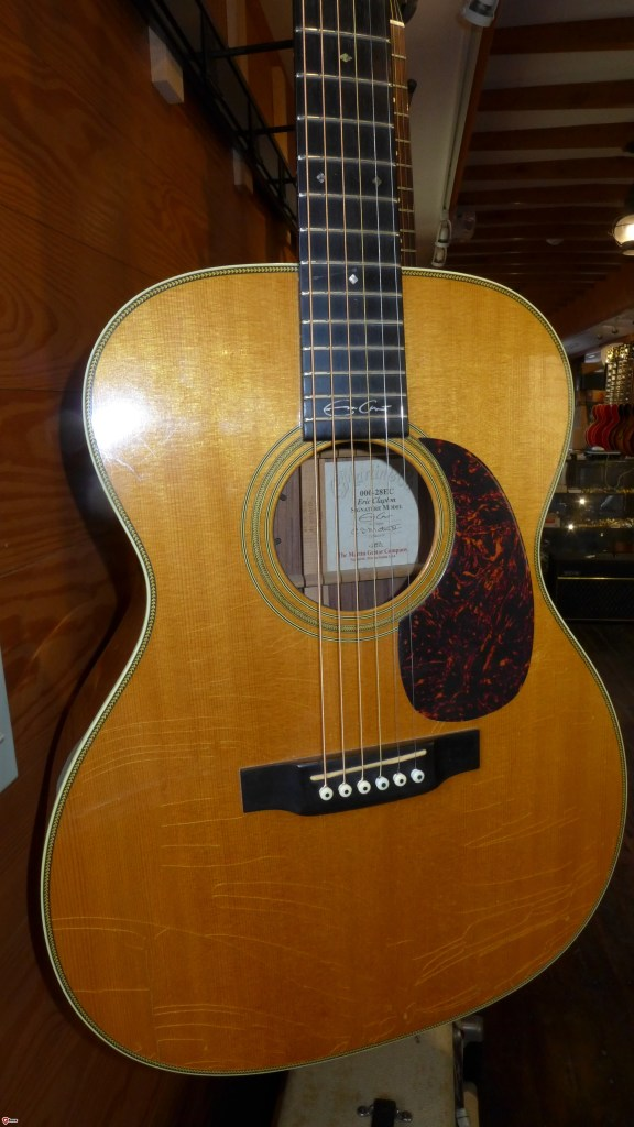 1999 Martin 000-28 Eric Clapton signature. Indian rosewood back and sides, Sitka top. In very good condition-some checking in the finish on top and one small, tight crack. $2200