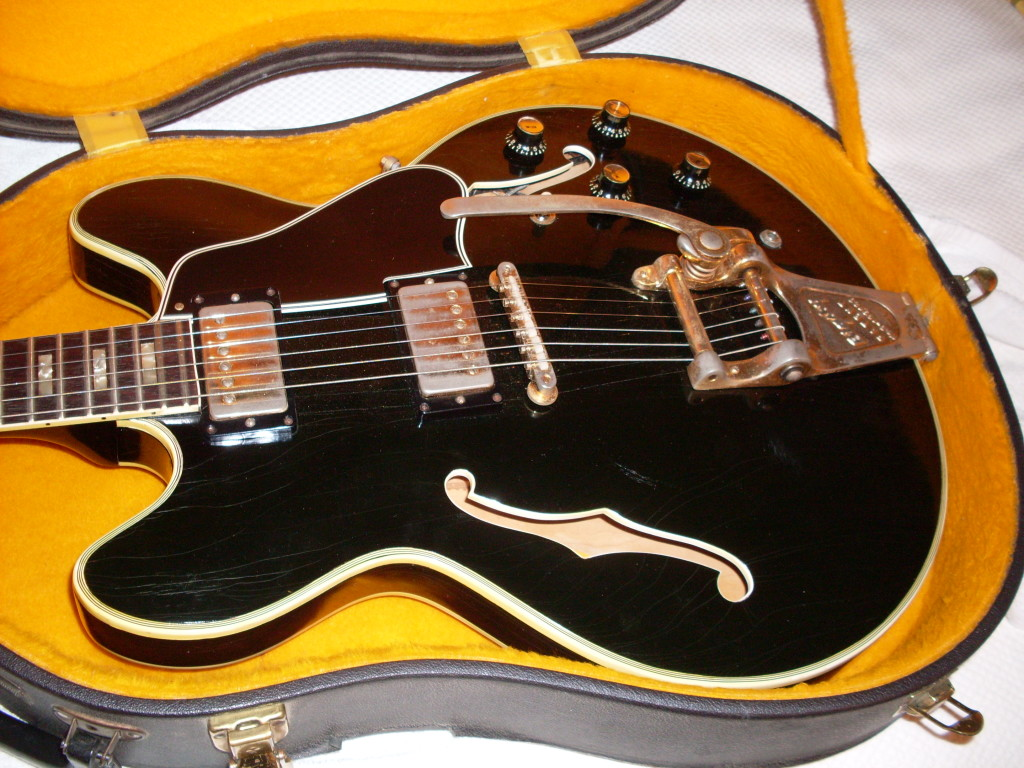 This is a factory black 1966 ES-335. It is a true one off factory custom with ES-355 7 ply binding on the top, bound f-holes and gold hardware. One of a kind unless you count the companion ES-330 that was ordered at the same time by the same buyer. I had that one too but now its gone. $16000