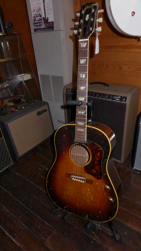 1958 J160-E. Like Lennons only older by a few years. All original except for the tuners. Lots of checking and character. Lots of wear but plays and sounds super. $3200