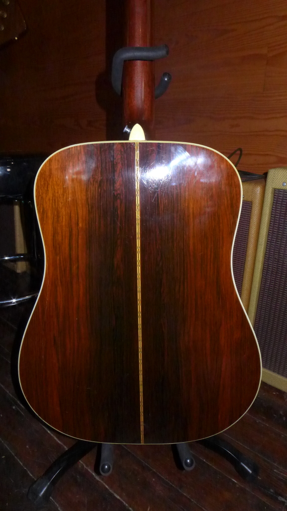 This is a 67 Martin D-28. You know what the front looks like so here's the main event-Brazilian rosewood. More photos on Gbase if you must see the front. $5000