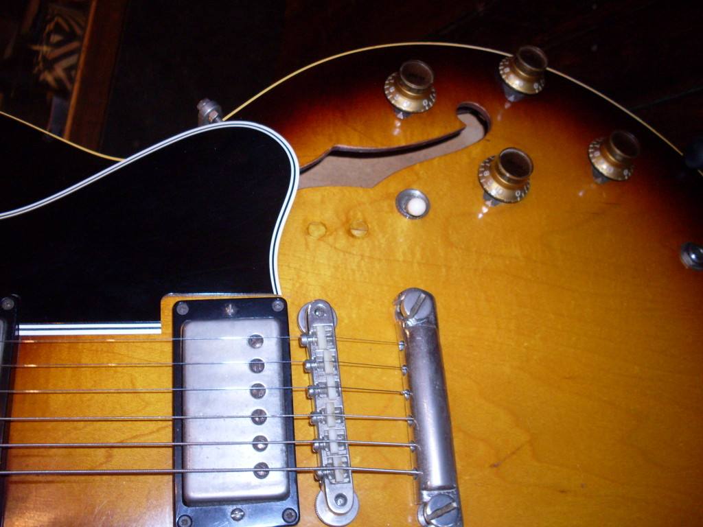 Yikes. Why would anyone do this? Because it was 1972 and this was just a ten year old guitar back then and the owner wanted a cutout and a phase switch. Knock off two or three thousand bucks for each hole.