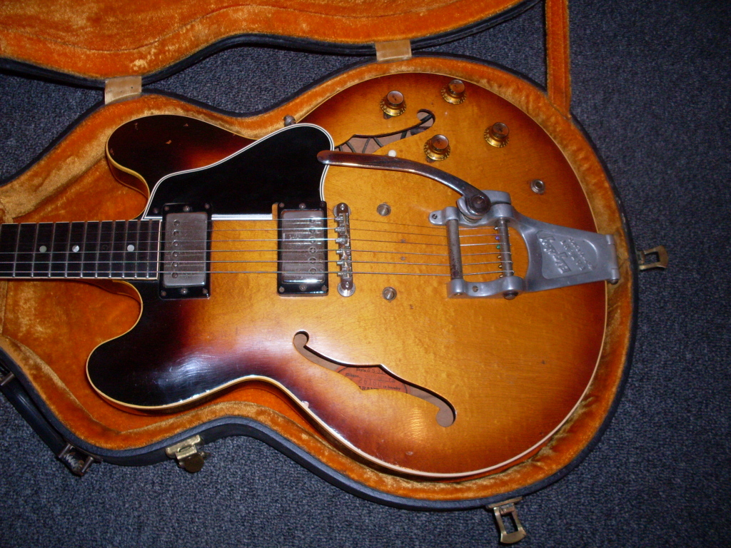 This 61 dot was played hard and was pretty beat up but it sold for under $12K. Still, it had no issues other than wear and two tine mystery holes behind the tailpiece.