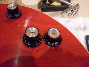 Not even close. How tough is it to get the knobs right? That's a real 60's reflector on the right. A blind person could tell the difference.
